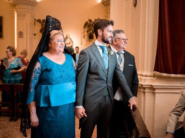 La boda de Adrián y Virginia en Los Palacios Y Villafranca, Sevilla 31