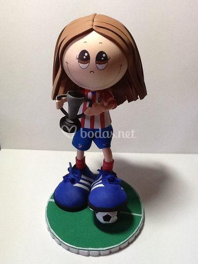 Jugadora Atlético con trofeo