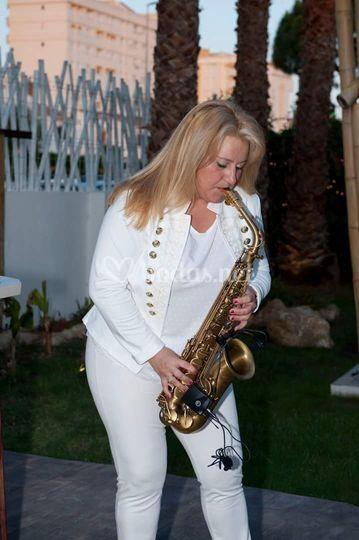 Saxofonista en el cóctel