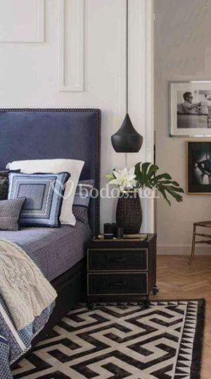 Dormitorio con cabecero tapiza