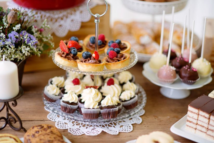 table-with-various-cookies-tarts-cakes-c