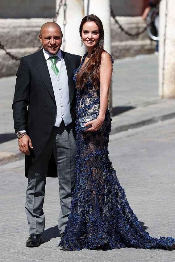 Roberto Carlos y su acompañante