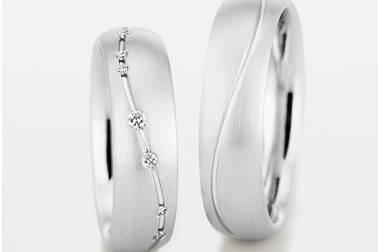 Alianzas en Oro Blanco y Diamantes talla Brillante.